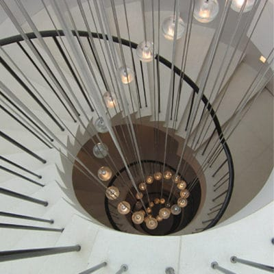 CIRCULAR CANTILEVER STONE STAIRCASE IN PORTLAND LIMESTONE