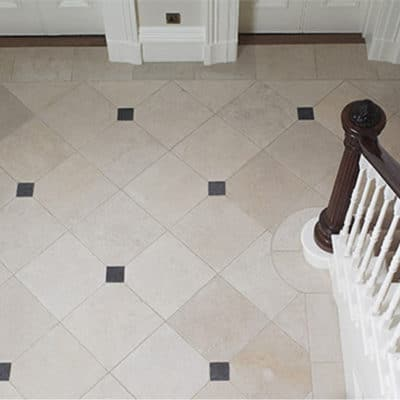 FONTAINE TUMBLED FLOOR WITH BORDER AND BELGIAN BLUE CABOCHANS