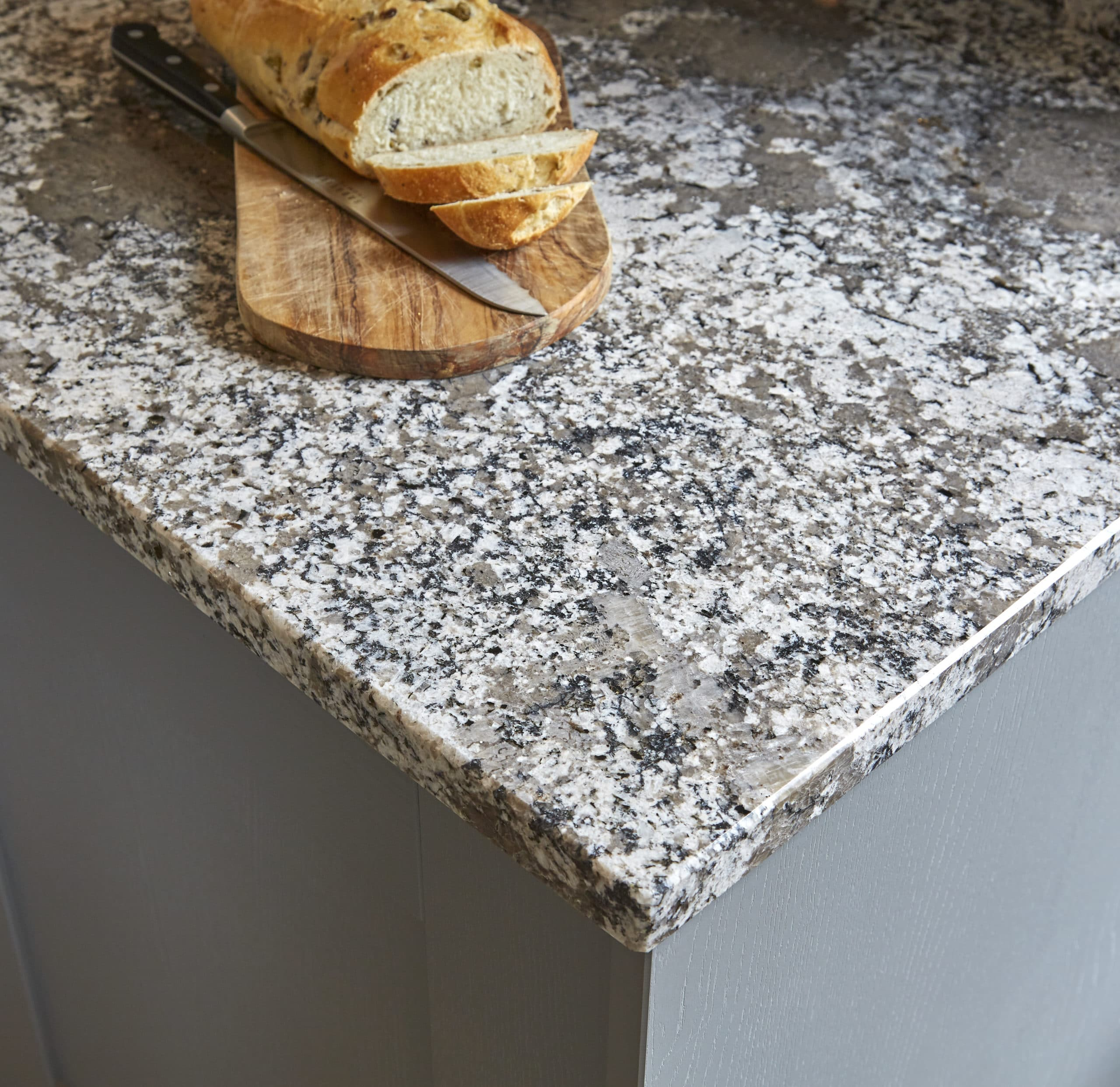 granite worktop with bread board and loaf